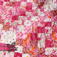 Scrappy Trip Along Pink Quilt